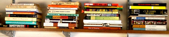 Stacked books on a shelf